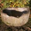 Abgerundeter, antiker Futtertrog aus Rochlitzer Porphyr